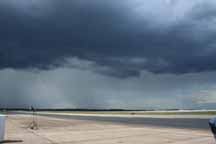 A massive downpour was produced by this storm cloud viewed from the runway on Quonset Point.