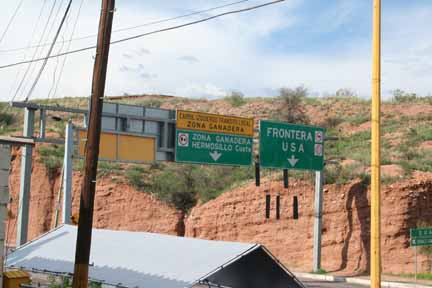 The border signs viewed from the parking lot of Horst Engineering de Mexico.