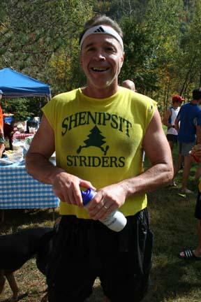 Bob Stoker basks in the sun following a strongrace.