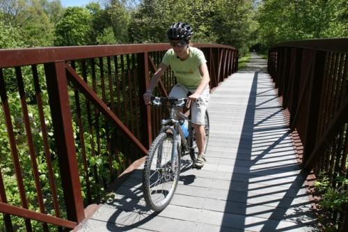 Deb cruises over an Air Line Trail bridge.